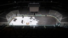 In this March 12, 2020, file photo, crews cover the ice at American Airlines Center in Dallas, home of the Dallas Stars hockey team, after the NHL season was put on hold due to the coronavirus. (Ashley Landis/The Dallas Morning News via AP, File)