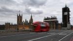 A double decker bus drives along an empty Westminster Bridge, due to the coronavirus outbreak in London, Wednesday, April 1, 2020. (AP Photo/Alberto Pezzali)