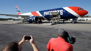In this Oct. 4, 2017, file photo, the New England Patriots customized Boeing 767 jet rests on the tarmac at T.F. Green Airport, in Warwick, R.I. The Patriots private team plane is expected to land in Boston on Thursday, April 2, 2020, returning from China with more than one million masks to help control the spread of the coronavirus. The new coronavirus causes mild or moderate symptoms for most people, but for some, especially older adults and people with existing health problems, it can cause more severe illness or death. (AP Photo/Steven Senne, File)