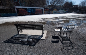 Empty benches and chairs are part of a dog park Tuesday March 31, 2020 in Ottawa. THE CANADIAN PRESS/Adrian Wyld