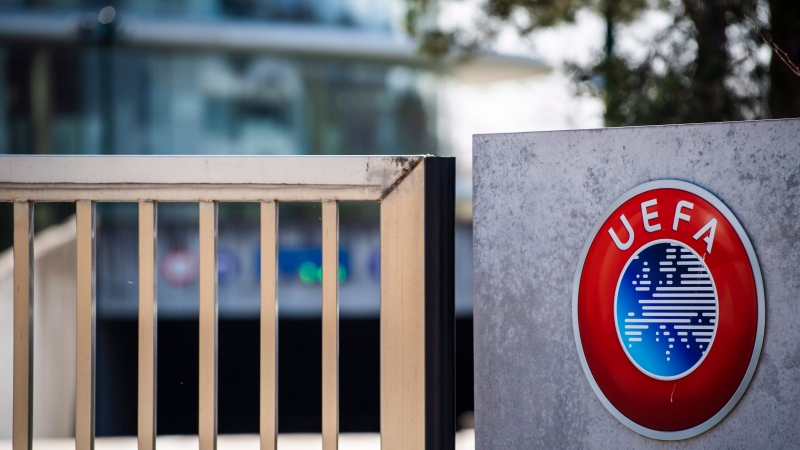 The UEFA logo displayed to the entrance of the UEFA Headquarters, in Nyon, Switzerland, Tuesday, March 17, 2020. (Jean-Christophe Bott/Keystone via AP)