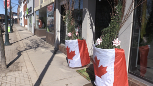 The storefront of Tamar's Trends Flower Shop is draped with Canadian flags and the owner is hoping the trend will catch on. April 2/2020 (Christian D'Avino/CTV News Northern Ontario)