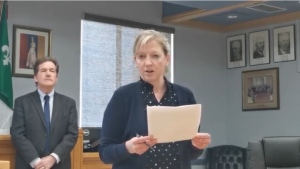 Dr. Lianne Catton, Medical Officer of Health for the Porcupine Health Unit announcing the 24th positive case of COVID-19 in its area as Timmins Mayor, George Pirie listens. (This photo is a still from the City of Timmins recording on YouTube posted April 2/2020)