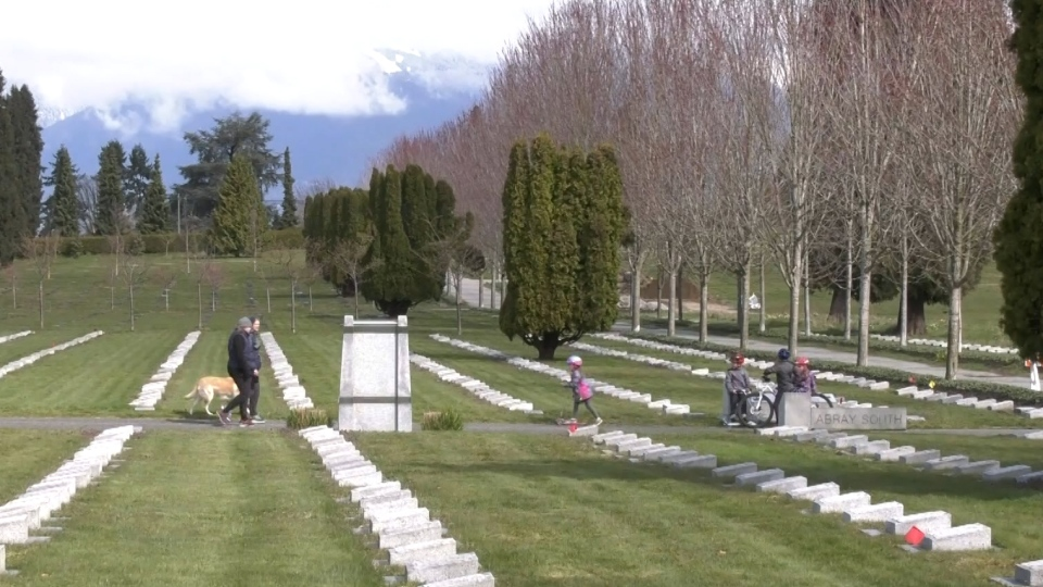 Parents and kids are seen in the Mountain View Cemetery in East Vancouver.