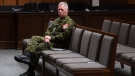 Chief of Defence Staff Jonathan Vance sits in chairs to ensure proper spacing between speakers during a news conference in Ottawa, Monday, March 30, 2020. THE CANADIAN PRESS/Adrian Wyld