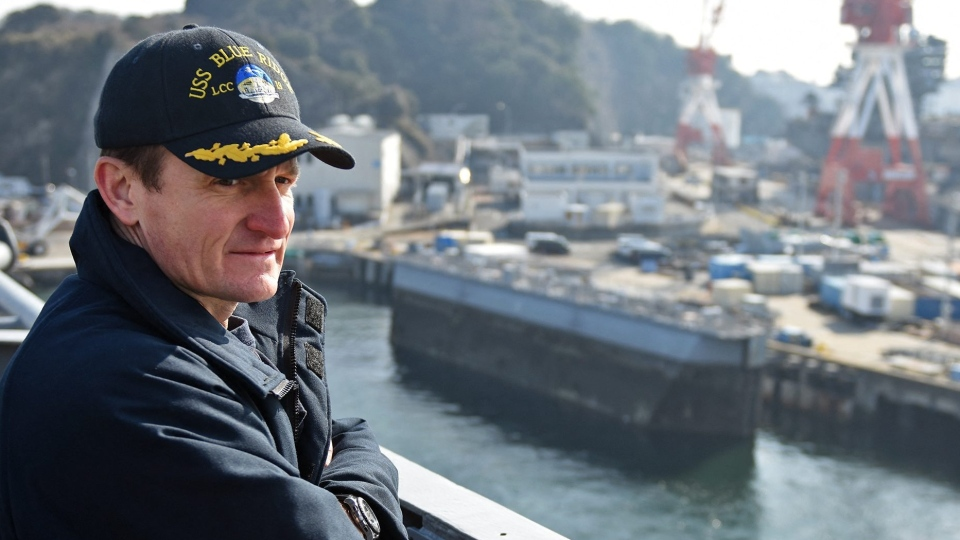 Handout file photo dated January 21, 2018 of Capt. Brett Crozier, then commanding officer of the U.S. 7th Fleet flagship USS Blue Ridge (LCC 19), observes from the ship's bridge as the ship departs from dry dock in Yokosuka, Japan. Photo by US Navy via ABACAPRESS.COM