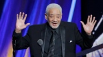 This April 18, 2015 file photo shows singer-songwriter Bill Withers speaking at the Rock and Roll Hall of Fame Induction Ceremony in Cleveland. (AP Photo/Mark Duncan, File)