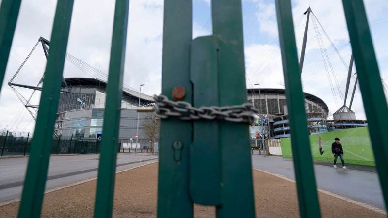 A locked gate at Etihad Stadium where Manchester City was due to play an English Premier League soccer match on March 14, 2020. (Jon Super / AP)