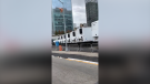 Multiple refrigerator trucks are seen lined up near Bellevue Hospital in New York City, New York, on April 1, 2020, after FEMA began deploying mobile morgues to help hospitals manage the overflow of coronavirus bodies. (Credit: Daniel Boyar via Storyful)
