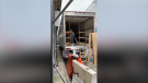 Workers are seen building shelves inside medical refrigeration trucks that are being used as temporary morgues near Bellevue Hospital in New York City, New York, on April 1, 2020. (Credit: Daniel Boyar via Storyful)