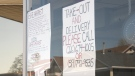 Generations Diner on Ottawa Street tapes a poster to the front window indicating its takeout options, as a result of a provincial order to close in an effort to prevent the spread of COVID-19. April 2, 2020. (Ricardo Veneza / CTV Windsor)