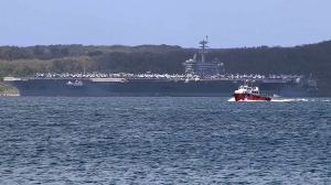 Sailors aboard the USS Theodore Roosevelt aircraft carrier cheered for Capt. Brett Crozier as he disembarked the ship for the last time. (CNN)