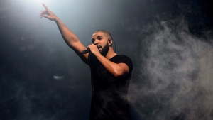 "Singer Drake performs on the main stage at Wireless festival in Finsbury Park, London on June 27, 2015. Toronto rap star Drake has found a new outlet during the COVID-19 pandemic: The ""Toosie Slide.""That's the name of a dance he introduces in his new song and music video of the same name. THE CANADIAN PRESS/AP, Invision - Jonathan Short"