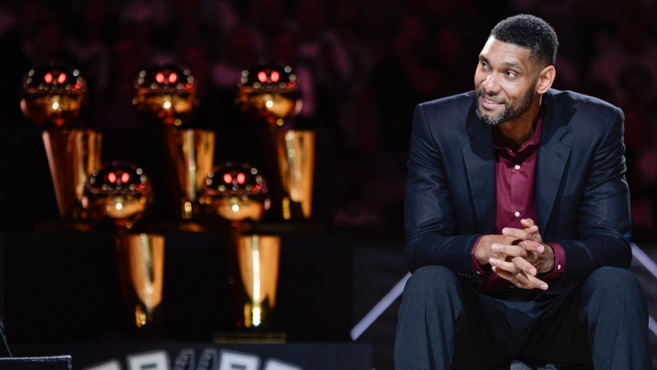 In this Dec. 18, 2016, file photo, San Antonio Spurs' Tim Duncan listens while special guests speak about him during his jersey retirement ceremony in San Antonio. Joining Kobe Bryant as first-time finalists for the Basketball Hall of Fame are: 15-time All-Star Duncan, fellow 15-time All-Star Kevin Garnett and 10-time WNBA All-Star and four-time Olympic gold medalist Tamika Catchings. (AP Photo/Darren Abate, File)