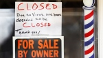 A closed sign is seen at a storefront during the COVID-19 pandemic. (The Canadian Press)