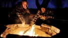 A couple warms themselves by a campfire in Colorado Springs, Colo. in this file photo from Jan. 21, 2010. ( The Denver Post/Craig F. Walker)