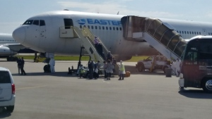 The Kirkhams boarded this plane in Fort Lauderdale to return home to Canada Friday, April 3, 2020. (CTV News)