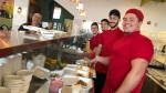 Staff at Caffé Demetré make crepes for long-term care home workers on April 3, 2020. (Beth Macdonell/CTV News Toronto)