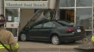 A tow-truck removes a car that crashed into the front of a bank on Mumford Road in Halifax. (VALENTINE NKENGBEZA / CTV ATLANTIC)