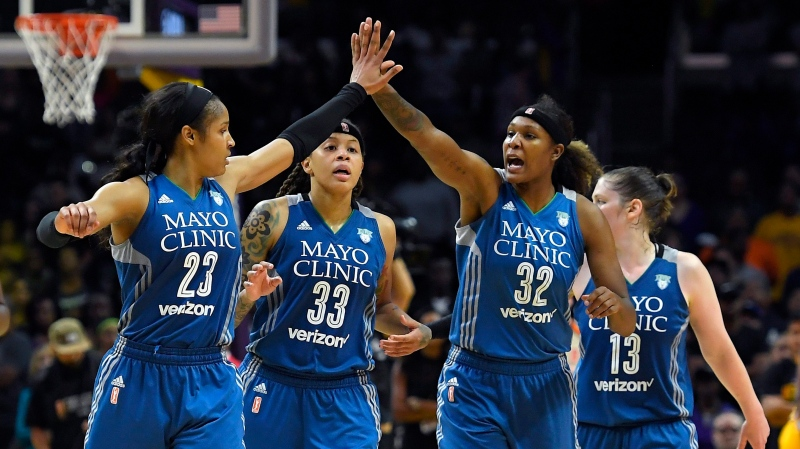 In this Oct. 16, 2016, file photo, members of the Minnesota Lynx, from left, Maya Moore, Seimone Augustus, Rebekkah Brunson and Lindsay Whalen celebrate during the second half in Game 4 of the WNBA Finals against the Los Angeles Sparks in Los Angeles. Augustus has left the Lynx after 14 seasons to join the Los Angeles Sparks.(AP Photo/Mark J. Terrill, File)