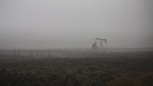 A pumpjack works at a well head on an oil and gas installation on a foggy day near Cremona, Alta., Saturday, Oct. 29, 2016. THE CANADIAN PRESS/Jeff McIntosh