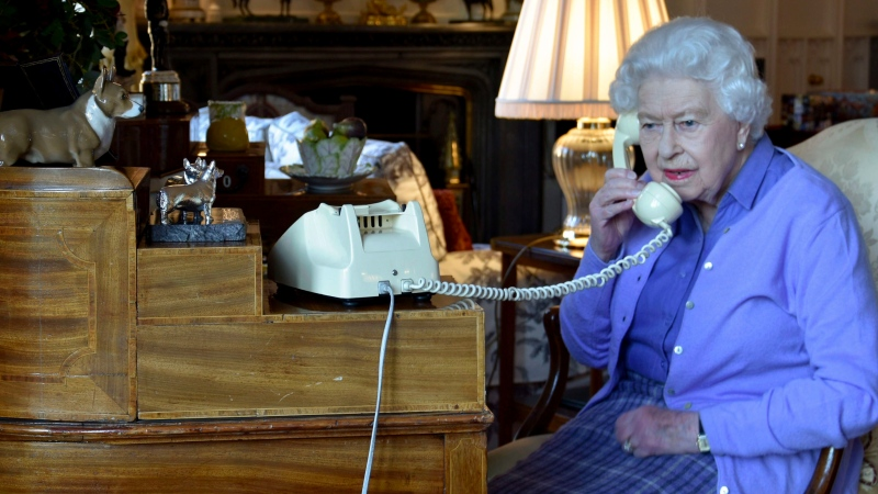 In this photo made available by Buckingham Palace, Queen Elizabeth II speaks to Prime Minister Boris Johnson from Windsor Castle, Windsor, England, Wednesday March 25, 2020, for her weekly audience. (Buckingham Palace via AP)