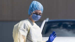 A healthcare worker is seen wearing full personal protection equipment outside the Royal Columbia Hospital in New Westminster, B.C. Friday, April 3, 2020. THE CANADIAN PRESS/Jonathan Hayward