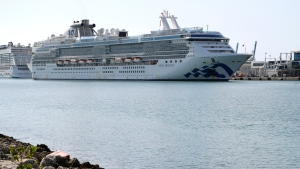 The Coral Princess cruise ship arrives at PortMiami during the new coronavirus outbreak, Saturday, April 4, 2020, in Miami. According to Princess Cruises, disembarkation of guests is expected to take several days due to limited flight availability. Guests requiring shoreside medical care will be prioritized to disembark first. (AP Photo/Lynne Sladky)