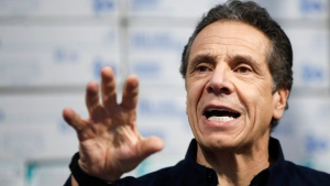 In this March 24, 2020 photo, New York Gov. Andrew Cuomo speaks during a news conference against a backdrop of medical supplies at the Jacob Javits Center that will house a temporary hospital in response to the COVID-19 outbreak in New York. (AP Photo/John Minchillo)