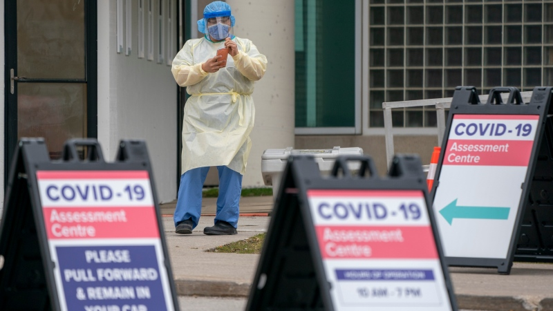 An intake nurse waits for patients at the COVID-19 testing centre in Toronto on Saturday April 4, 2020. THE CANADIAN PRESS/Frank Gunn