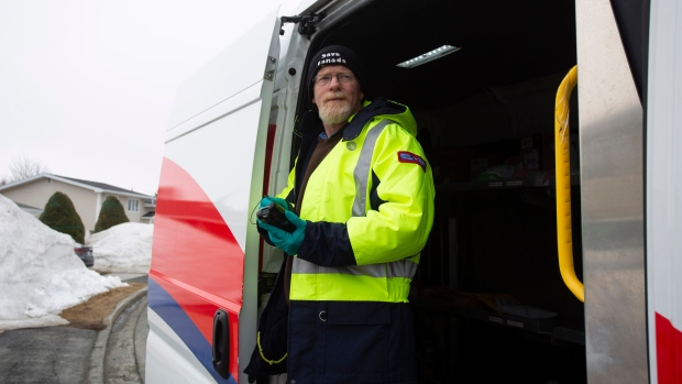 Craig Dyer, a postal worker, is back on the job delivering mail in Mount Pearl, N.L., on Friday, April 3, 2020 following a two-week isolation period when a co-worker tested positive for COVID 19. (THE CANADIAN PRESS/Paul Daly)
