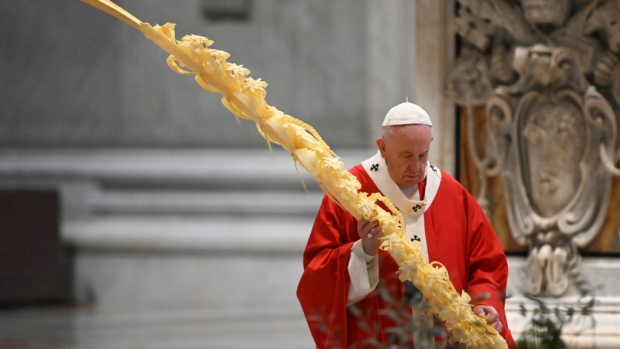 Pope Francis celebrated Palm Sunday mass behind closed doors at St. Peter's on Sunday. (AFP)