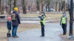Police cadets keep an eye on social distancing in Lafontaine Park Friday April 3, 2020 in Montreal.THE CANADIAN PRESS/Ryan Remiorz