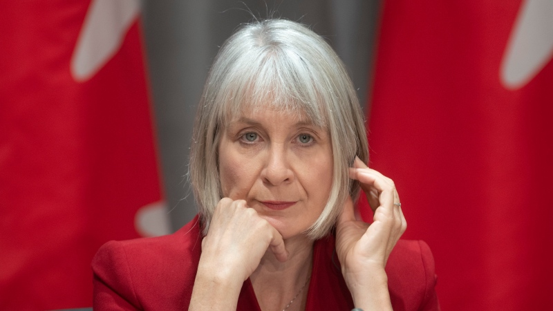 Minister of Health Patty Hajdu listens to a translation aid during a news conference in Ottawa, Wednesday, April 1, 2020. (THE CANADIAN PRESS / Adrian Wyld)
