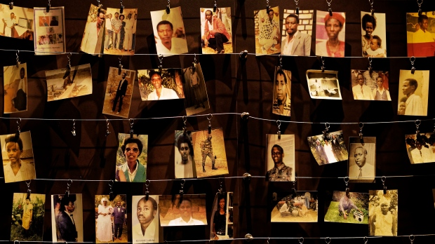 Family photos of some of those who died hang on display in an exhibition at the Kigali Genocide Memorial centre in the Rwandan capital, Kigali, on April 5, 2019. (AP Photo/Ben Curtis)