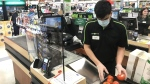 A plexiglass barrier is pictured creating a barrier to protect a cashier at a grocery store in North Vancouver, B.C. Sunday, March 22, 2020. (THE CANADIAN PRESS / Jonathan Hayward)