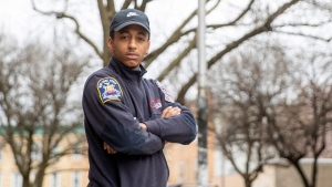 In this Saturday, April 4, 2020 photo, emergency medical technician Josh Allert poses for a photo in New York. Thousands of workers have been thrust onto the front lines of the coronavirus emergency in New York City. That includes Allert, whose days are a blur and a battle. (AP Photo/Mary Altaffer)