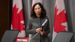 Chief Public Health Officer Theresa Tam takes her seat for a news conference in Ottawa, Friday April 3, 2020. THE CANADIAN PRESS/Adrian Wyld