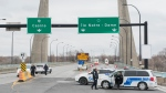 Police and security block access to Ile Notre-Dame in Montreal, Sunday, April 5, 2020, as Coronavirus COVID-19 cases rise in Canada and around the world. The city of Montreal has closed parking lots in some city parks. THE CANADIAN PRESS/Graham Hughes