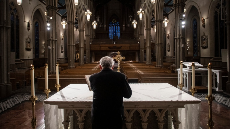 Cardinal Thomas Collins, the Catholic Archbishop of Toronto, prepares to perform a live-streamed mass at St. Michael's Cathedral in Toronto, on Wednesday, March 25, 2020, after churches were closed due to the COVID-19 pandemic. (THE CANADIAN PRESS / Chris Young)