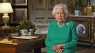 """In this image taken from video and made available by Buckingham Palace, Queen Elizabeth II addresses the nation and the Commonwealth from Windsor Castle, Windsor, England, Sunday April 5, 2020. Queen Elizabeth II made a rare address, calling on Britons to rise to the challenge of the coronavirus pandemic, to exercise self-discipline in """"an increasingly challenging time"""". (Buckingham Palace via AP)"""
