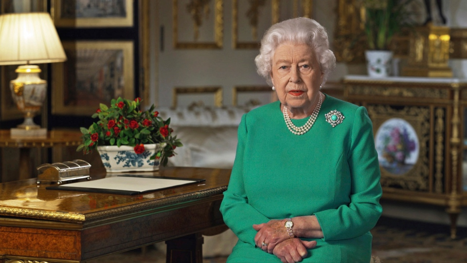 "In this image taken from video and made available by Buckingham Palace, Queen Elizabeth II addresses the nation and the Commonwealth from Windsor Castle, Windsor, England, Sunday April 5, 2020. Queen Elizabeth II made a rare address, calling on Britons to rise to the challenge of the coronavirus pandemic, to exercise self-discipline in ""an increasingly challenging time"". (Buckingham Palace via AP)"