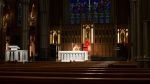 Cardinal Thomas Collins, the Catholic Archbishop of Toronto, performs a live-streamed mass at St. Michael's Cathedral in Toronto, on Wednesday March 25, 2020, after churches were closed due to the COVID-19 pandemic. THE CANADIAN PRESS/Chris Young