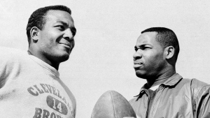 FILE - In this Jan. 11, 1964, file photo, fullback Jim Brown, left, and flanker back Bobby Mitchell, once a feared duo for the Cleveland Browns before Mitchell was dealt to Washington, are back together as teammates, as they prepare for the annual Pro Bowl at Los Angeles. (AP Photo/Harold Filan, File)