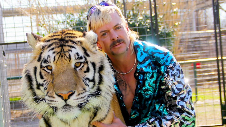 Joseph Maldonado-Passage aka Joe Exotic and one of his cats in the Netflix docuseries