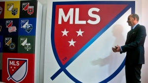 Major League Soccer Commissioner Don Garber launch the league's new logo during a press conference in New York, on Sept. 18, 2014. (Bebeto Matthews / THE CANADIAN PRESS / AP)