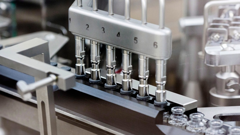 In this March 2020 photo provided by Gilead Sciences, rubber stoppers are placed onto filled vials of the investigational drug remdesivir at a Gilead manufacturing site in the United States. (Gilead Sciences via AP)