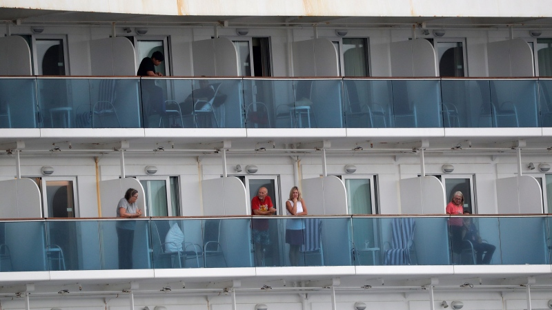Passengers look out from the Coral Princess cruise ship while docked in Miami, Monday, April 6, 2020. (AP / Wilfredo Lee)