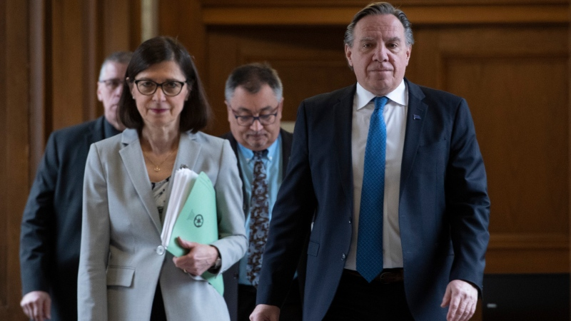 Quebec Health Minister Danielle McCann, left, Quebec Premier Francois Legault, right, and Horacio Arruda, Quebec director of National Public Health, rear, walk to a news conference on the COVID-19 pandemic at the legislature in Quebec City. THE CANADIAN PRESS/Jacques Boissinot