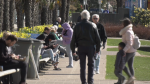Members of the public are pictured at English Bay in Vancouver on Sunday, April 5, 2020.
